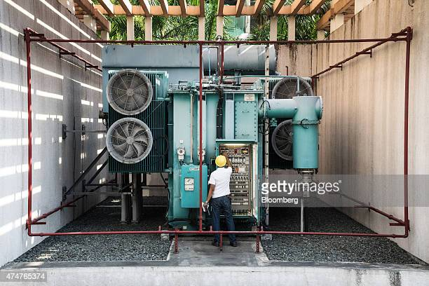 Caretaker Robert Rillera inspects a transformer during maintenance operations at the Manila Electric Co Gas Insulated Switch Gear Sub Station in the...