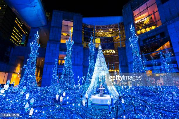 caretta illumination show decoration, which is illuminated by approximately 250,000 led lights every 20 minutes in caretta shopping mall shiodome tokyo japan on january 16 2018. - beauty and the beast musical stock photos and pictures