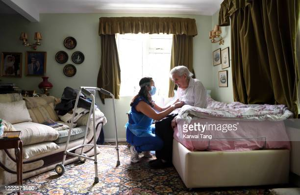 Careworker Fabiana Connors visits client Jack Hornsby at his home during the coronavirus pandemic on May 3, 2020 in Elstree, England. Fabiana Connors...