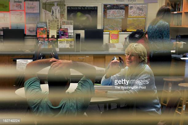 Carey Crimmel, an English language learning teacher, works one-on-one with a student detainee at the Fairfax County Juvenile Detention Center School...