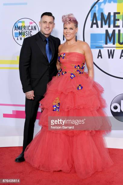 Carey Hart and Amanda 'Pink' Moore attend the 2017 American Music Awards at Microsoft Theater on November 19 2017 in Los Angeles California