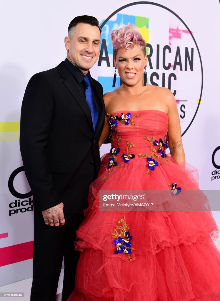 Carey Hart (L) and Pink attend the 2017 American Music Awards at Microsoft Theater on November 19, 2017 in Los Angeles, California.