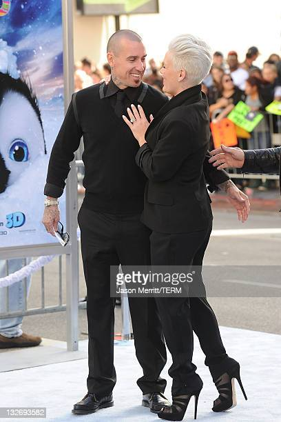 Carey Hart and Singer Pink attend the 'Happy Feet Two' Los Angeles Premiere at Grauman's Chinese Theatre on November 13 2011 in Hollywood California