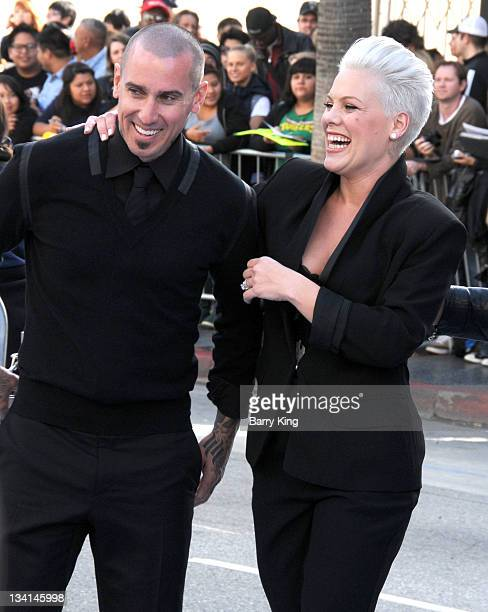 Carey Hart and singer/actress Alecia 'Pink' Moore arrives at the Los Angeles premiere of 'Happy Feet Two' held at Grauman's Chinese Theatre on...