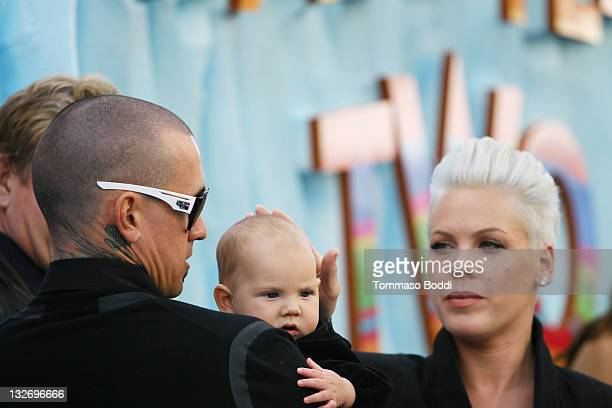 Carey Hart Pink and Willow Sage Hart attend the 'Happy Feet Two' Los Angeles premiere held at the Grauman's Chinese Theatre on November 13 2011 in...