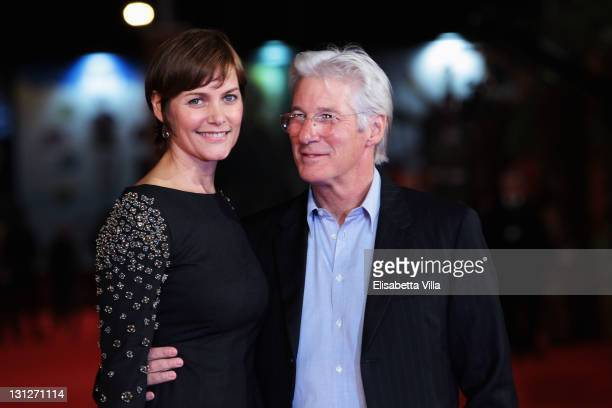 Carey Lowell and Richard Gere walk the red carpet during the 6th International Rome Film Festival on November 3 2011 in Rome Italy