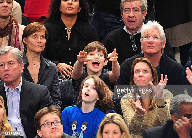 Carey Lowell, Homer James Gere and Richard Gere attend the Chicago Bulls VS New York Knicks at Madison Square Garden on February 2, 2012 in New York...