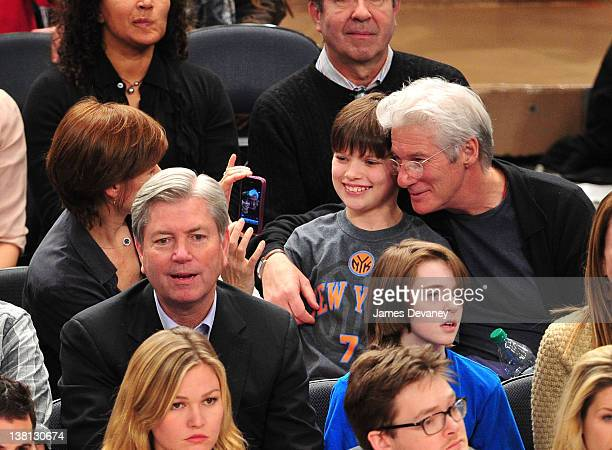 Carey Lowell Homer James Gere and Richard Gere attend the Chicago Bulls VS New York Knicks at Madison Square Garden on February 2 2012 in New York...
