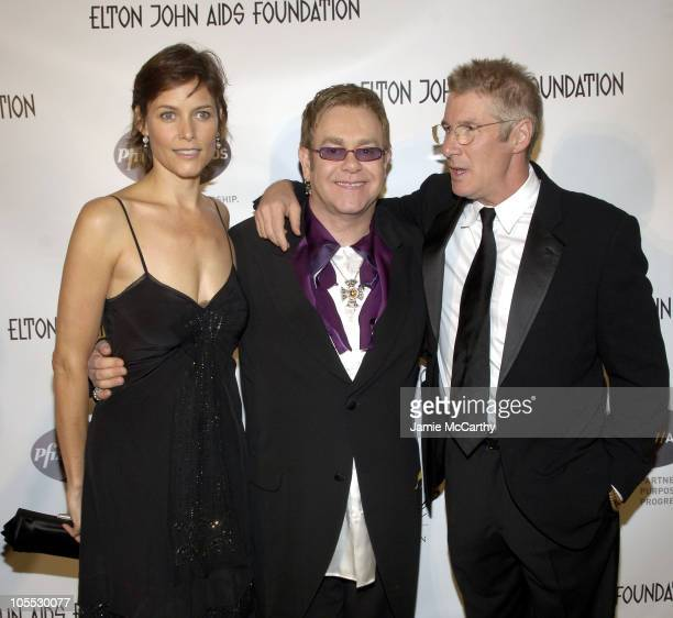 Carey Lowell Sir Elton John and Richard Gere during An Enduring Vision A Benefit for the Elton John AIDS Foundation at Cipriani Wall Street in New...