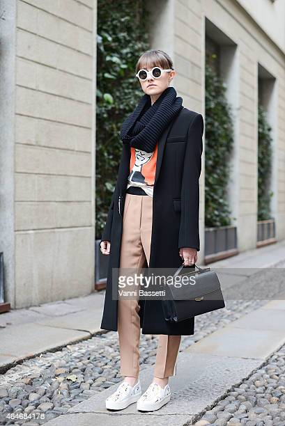 Carey Melnichuck poses wearing an Anthony Vaccarello coats, Sandro pants, Fendi bag and N21 shoes during Milan Fashion Week on February 27, 2015 in...