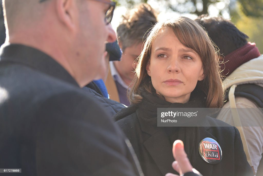 Carey Mulligan (R), actor and Ambassador for War Child, attends in the 'Rally for Aleppo' outside Downing Street on October 22, 2016 in London, England. The protest was held in support of people in Aleppo, Syria and an attempt to stop the violence in the area. The demonstration was organised by Amnesty International UK, Avaaz, Big Heart, Council on Arab British Understanding (CAABU), CARE International UK, Christian Aid, Doctors of the World UK, Human Appeal, International Rescue Committee UK, Syria Relief, The Syria Campaign, War Child, ChildrenPlus and WATAN.