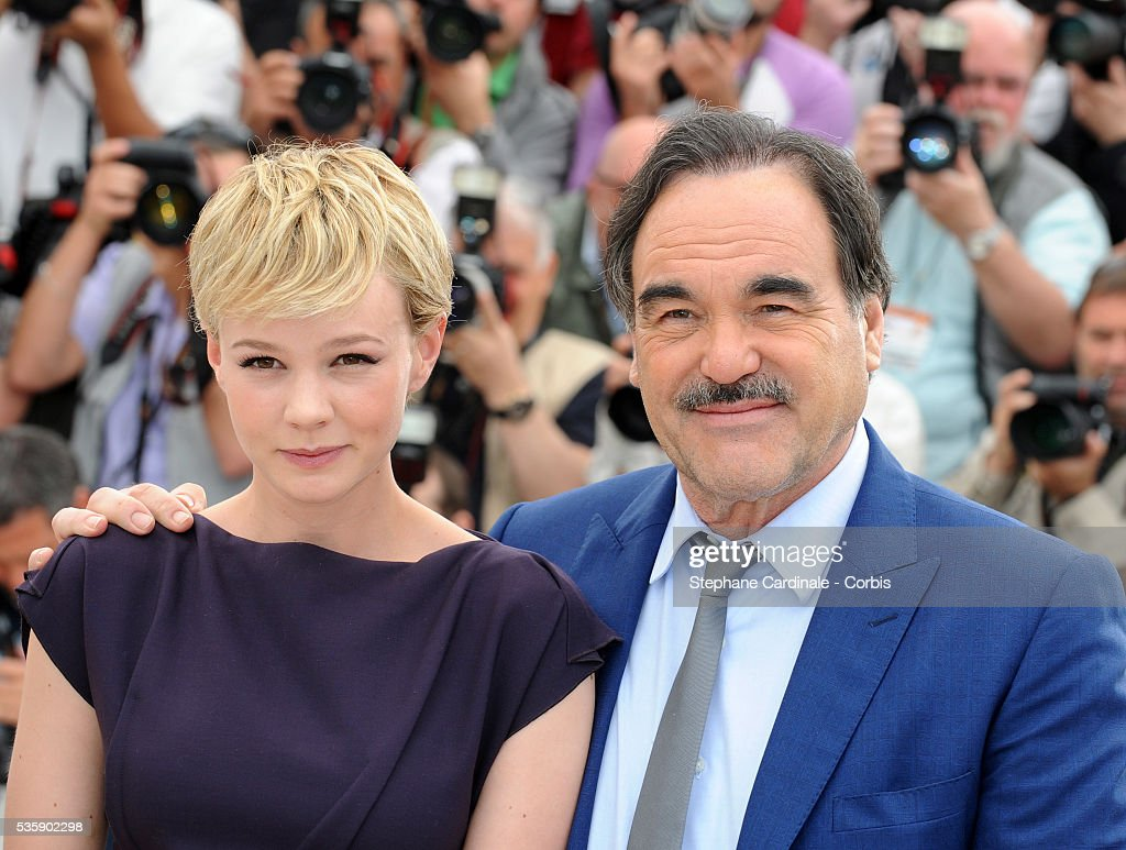 Carey Mulligan and Oliver Stone at the photocall for 'Wall street : Money never sleeps' during the 63rd Cannes International Film Festival.