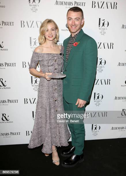 Carey Mulligan and Sam Smith attend the Harper's Bazaar Women of the Year Awards at Claridge's Hotel on November 2 2017 in London England