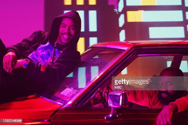 """Carey Mulligan"""" Episode 1802 -- Pictured: Musical guest Kid Cudi and Chris Redd during the """"WLF"""" sketch on Saturday, April 10, 2021 --"""