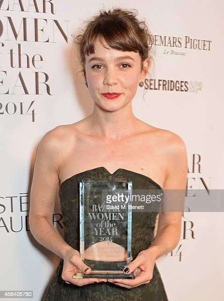 Carey Mulligan, winner of the Bazaar Inspiration award, poses at the Harper's Bazaar Women Of The Year awards 2014 at Claridge's Hotel on November 4,...