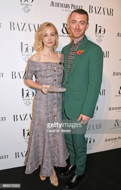 Carey Mulligan winner of the Philanthropist Award and Sam Smith attend Harper's Bazaar Women of the Year Awards in association with Ralph Russo...