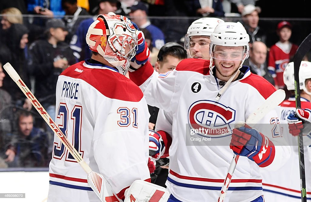 Carey Price #31 and Alex Galchenyuk #27 of the Montreal Canadiens celebrate the teams win over the Toronto Maple Leafs during NHL game action April 11, 2015 at the Air Canada Centre in Toronto, Ontario, Canada.