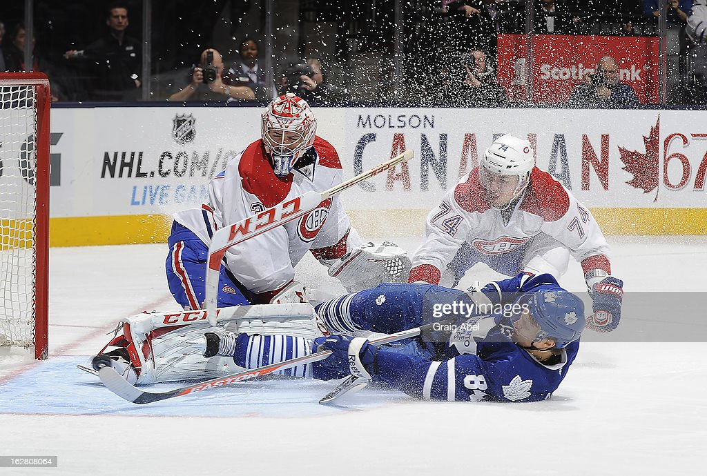Carey Price #31 and Alexei Emelin #74 of the Montreal Canadiens defend as Mikhail Grabovski #84 of the Toronto Maple Leafs crashes the goal during NHL game action February 27, 2013 at the Air Canada Centre in Toronto, Ontario, Canada.