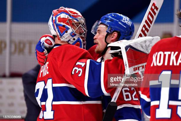 Carey Price and Artturi Lehkonen of the Montreal Canadiens congratulate each other on the team's 3-2 overtime win against the Vegas Golden Knights in...