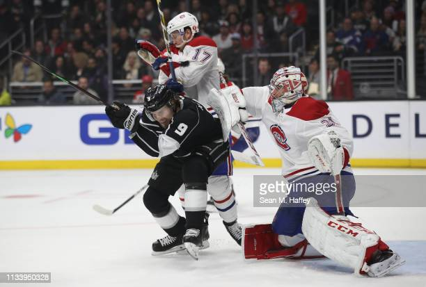 Carey Price and Brett Kulak of the Montreal Canadiens defend as Adrian Kempe of the Los Angeles Kings dodges a shot on goal during the second period...