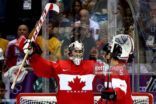 Carey Price and Dan Hamhuis of Canada celebrate after defeating Sweden 30 during the Men's Ice Hockey Gold Medal match on Day 16 of the 2014 Sochi...