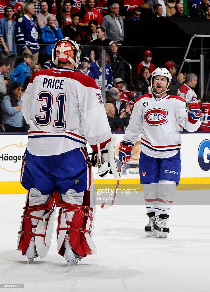 Carey Price #31 and David Desharnais #51 of the Montreal Canadiens celebrate the teams win over the Toronto Maple Leafs during NHL game action April 11, 2015 at the Air Canada Centre in Toronto, Ontario, Canada.
