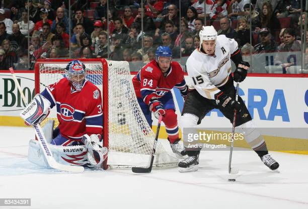 Carey Price and Guillaume Latendresse of the Montreal Canadiens defend against a wraparound attempt by Ryan Getzlaf of the Anaheim Ducks at the Bell...