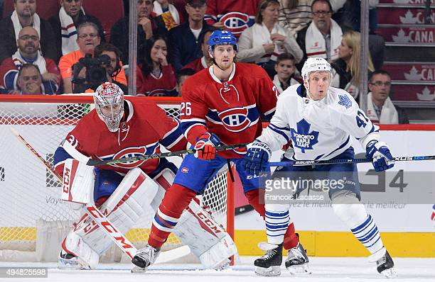 Carey Price and Jeff Petry of the Montreal Canadiens defend the goal against the Toronto Maple Leafs in the NHL game at the Bell Centre on October 24...