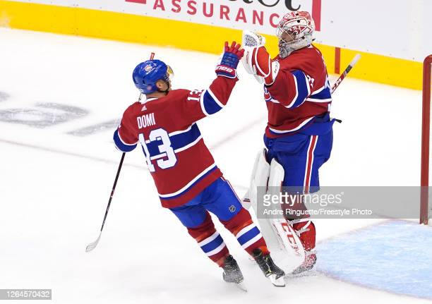 Carey Price and Max Domi of the Montreal Canadiens celebrate the win over the Pittsburgh Penguins in Game Four of the Eastern Conference...
