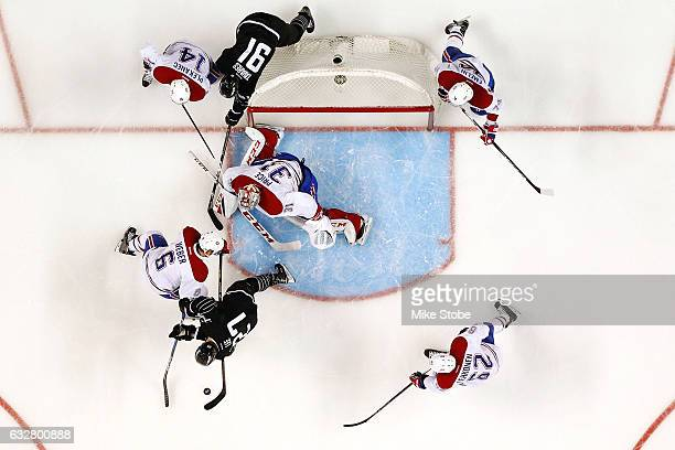 Carey Price and Shea Weber of the Montreal Canadiens defend the net against Anders Lee of the New York Islanders at the Barclays Center on January 26...