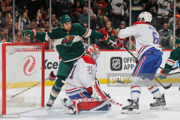 Carey Price and Shea Weber of the Montreal Canadiens defend their goal against Chris Stewart and the Minnesota Wild during the game at the Xcel...