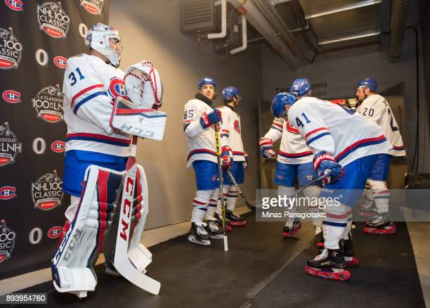 Carey Price Andrew Shaw and Paul Byron of the Montreal Canadiens prepare to start the second period in a game against the Ottawa Senators during the...