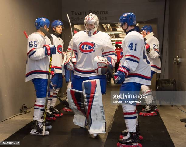 Carey Price, Andrew Shaw and Paul Byron of the Montreal Canadiens walk to the ice at the start of the second period in a game against the Ottawa...
