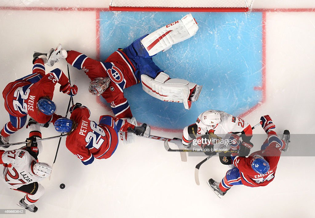 Carey Price #31, Dale Weise #22 and Jeff Petry #26of the Montreal Canadiens defend the goal against Curtis Lazar #27 and Erik Condra #22 of Ottawa Senators in Game One of the Eastern Conference Quarterfinals during the 2015 NHL Stanley Cup Playoffs at the Bell Centre on April 15, 2015 in Montreal, Quebec, Canada.