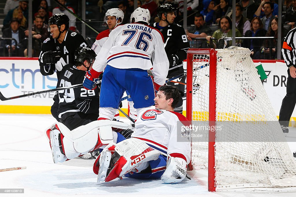 Carey Price #31 gets taken down while P.K. Subban #76 of the Montreal Canadiens defends the net against the New York Islanders at the Barclays Center on November 20, 2015 in Brooklyn borough of New York City. The Canadiens defeated the Islanders 5-3.