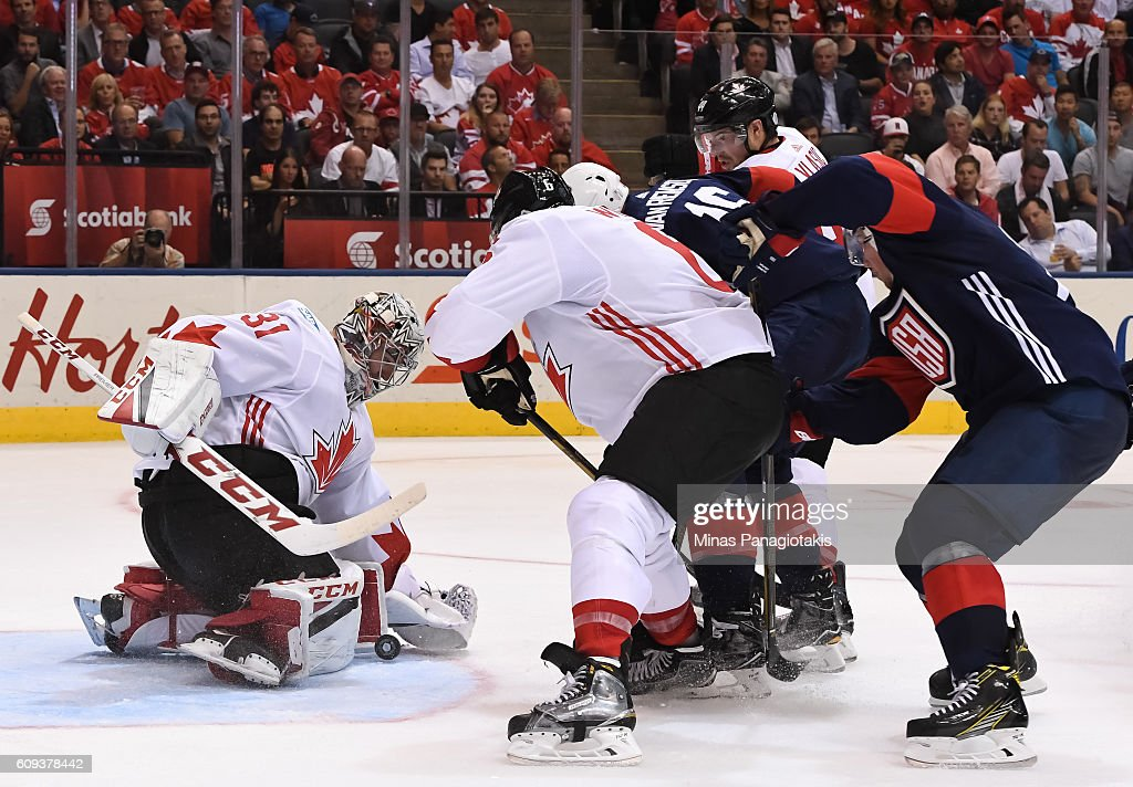 Carey Price #31 makes a save with Shea Weber #6 of Team Canada and James Van Riemsdyk #16 of Team USA battling in front during the World Cup of Hockey 2016 at Air Canada Centre on September 20, 2016 in Toronto, Ontario, Canada.