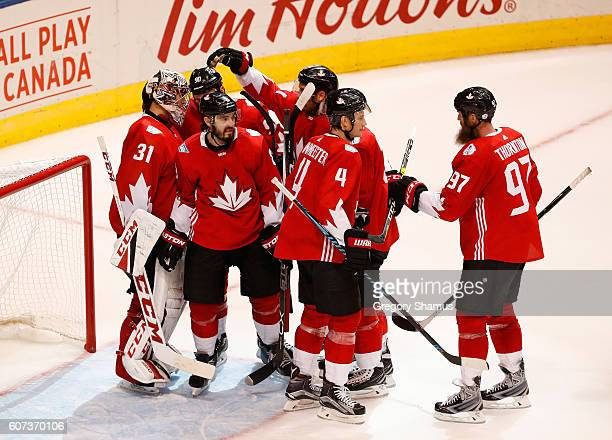 Carey Price of Team Canada celebrates a 60 win over Team Czech Republic with teammates during the World Cup of Hockey at the Air Canada Center on...