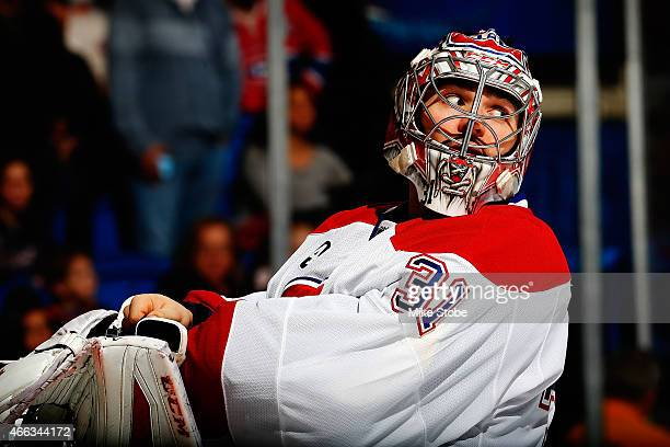 Carey Price of the Montreal Canadiens adjusts his glove during a stoppage of play against the New York Islanders at Nassau Veterans Memorial Coliseum...