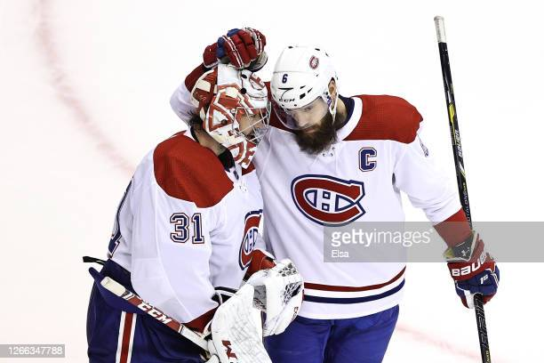 Carey Price of the Montreal Canadiens celebrates with Shea Weber after defeating the Philadelphia Flyers in Game Two of the Eastern Conference First...