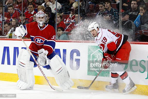 Carey Price of the Montreal Canadiens clears the puck in front of Chad LaRose of the Carolina Hurricanes during the NHL game at the Bell Centre on...