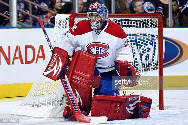 Carey Price of the Montreal Canadiens concentrates on the puck during a game against the Montreal Canadiens on October 10, 2009 at Rexall Place in...