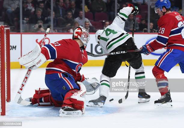 Carey Price of the Montreal Canadiens defends the goal against Jamie Benn of the Dallas Stars in the NHL game at the Bell Centre on October 30 2018...