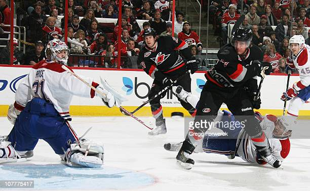 Carey Price of the Montreal Canadiens deflects a shot by Troy Bodie of the Carolina Hurricanes during a NHL game on December 23 2010 at RBC Center in...