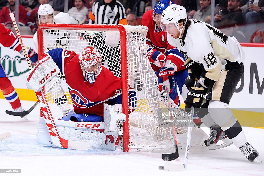 Carey Price #31 of the Montreal Canadiens gets down to stop the wrap around attempt by James Neal #18 of the Pittsburgh Penguins during the NHL game at the Bell Centre on March 2, 2013 in Montreal, Quebec, Canada.