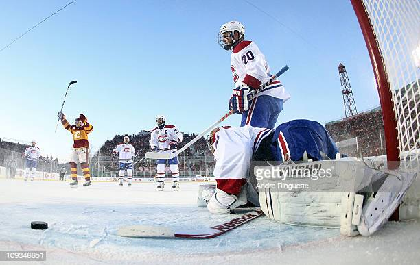 Carey Price of the Montreal Canadiens gives up a goal against the Calgary Flames during the 2011 NHL Heritage Classic Game at McMahon Stadium on...