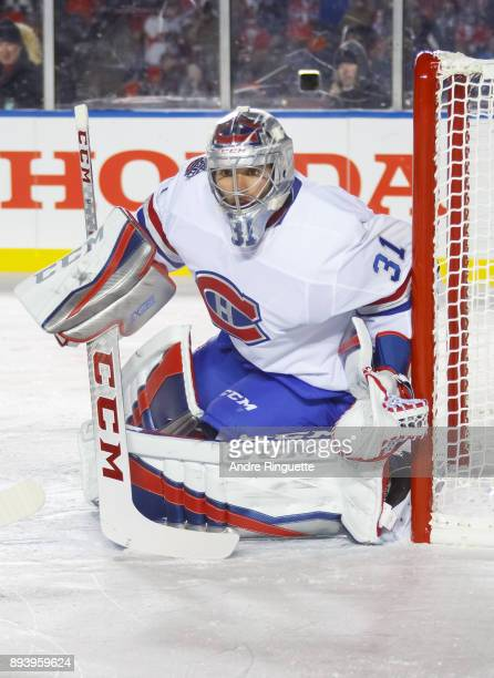 Carey Price of the Montreal Canadiens guards his net against the Ottawa Senators during the third period of the 2017 Scotiabank NHL100 Classic at...