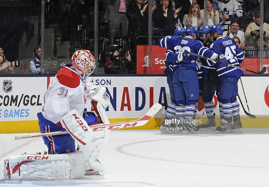 Carey Price #31 of the Montreal Canadiens looks on as Clarke MacArthur #16 of the Toronto Maple Leafs celebrates a second period goal with teammates during NHL game action February 27, 2013 at the Air Canada Centre in Toronto, Ontario, Canada.
