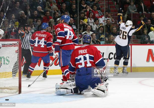 Carey Price of the Montreal Canadiens looks on as Thomas Vanek of the Buffalo Sabres celebrates his second goal of the game at the Bell Centre on...