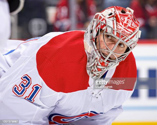 Carey Price of the Montreal Canadiens looks over at a teammate on a play stoppage during an NHL game against the Detroit Red Wings at Little Caesars...