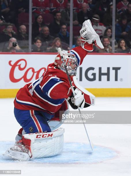 Carey Price of the Montreal Canadiens makes a glove save against the Detroit Red Wings in the NHL game at the Bell Centre on March 12 2019 in...